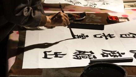 Person writing kanji characters