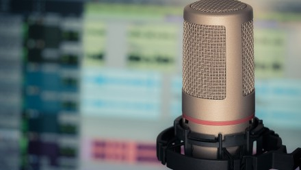 Microphone with blurred computer screen in background
